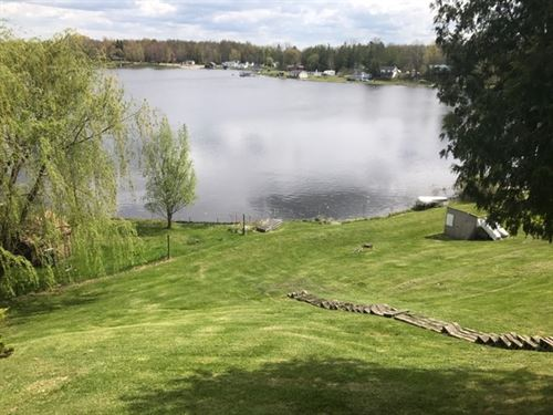 First Lake Frontage With Cabin : Six Lakes : Montcalm County : Michigan