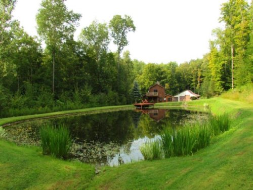 Log Home Borders State Land Pond : Solon : Cortland County : New York